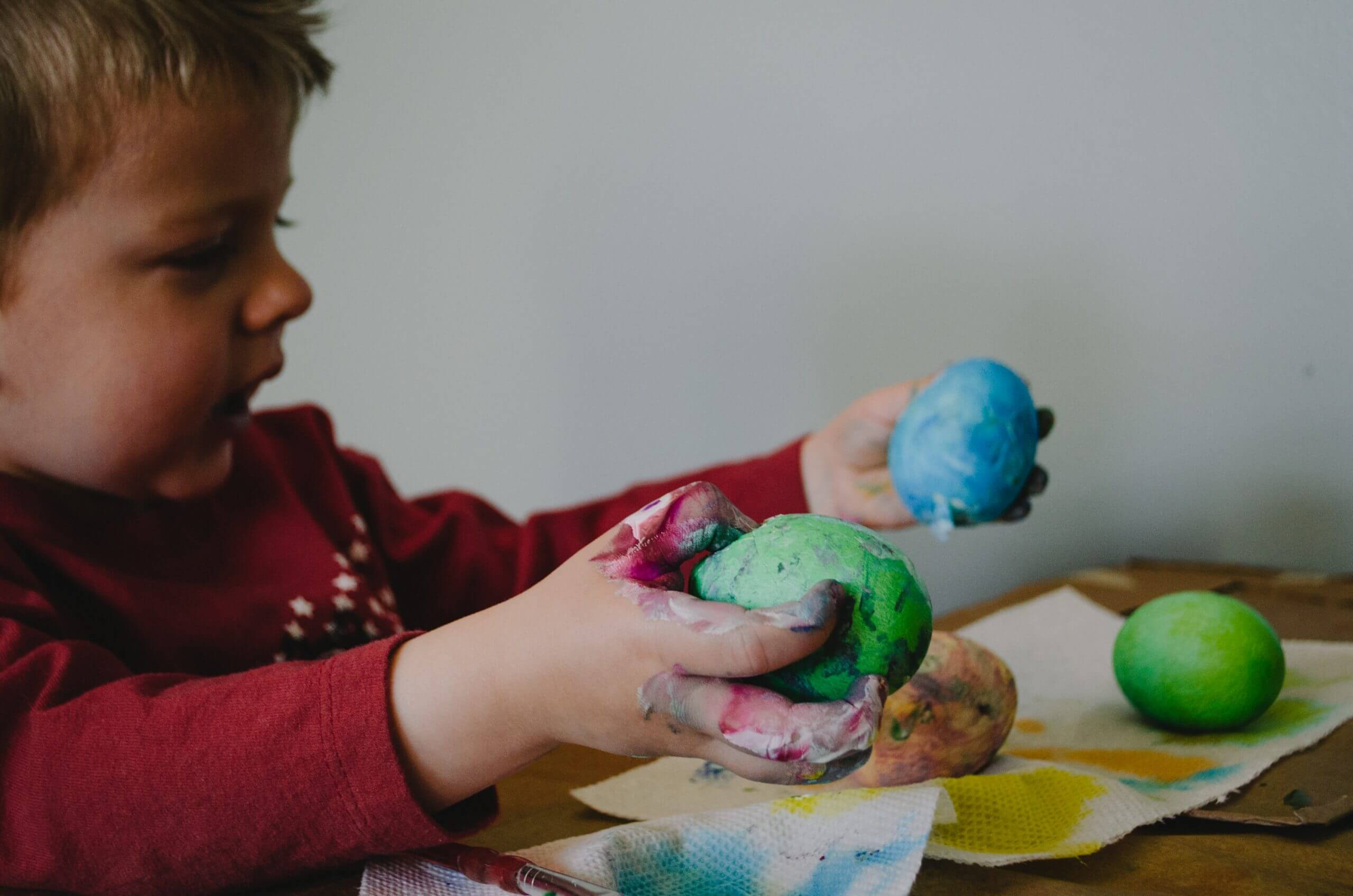 child playing playdough